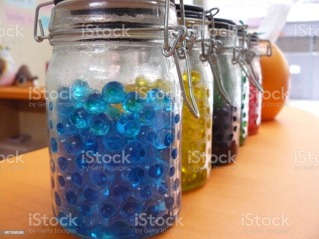 Colorful Jelly balls in glass jar. stock photo