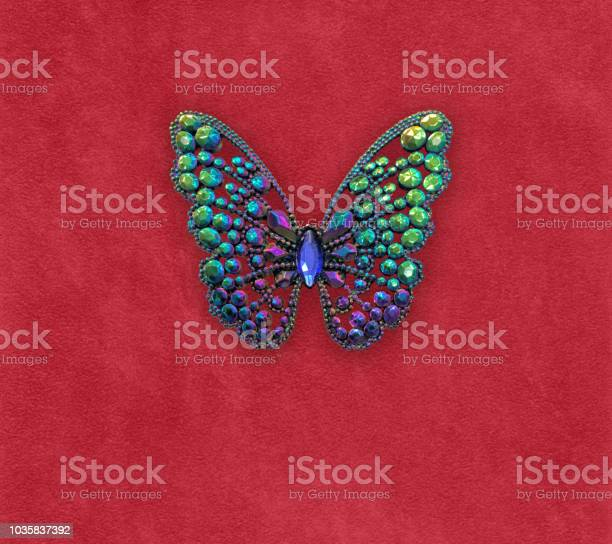 Colorful jeweled gem butterfly on red velvet background picture id1035837392?b=1&k=6&m=1035837392&s=612x612&h=hhktmivh6pnyfw0vap4rfzvgajxo8b21t8pmf 5vti0=