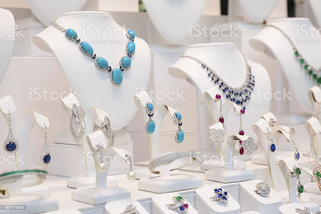 Colorful jewelry window display on white manikin stock photo