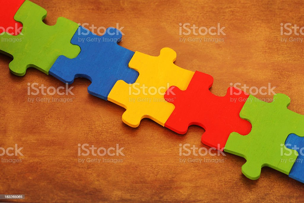 A colorful jigsaw puzzle on a brown table stock photo
