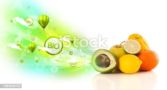 istock Colorful juicy fruits with green eco signs and icons 1084848702