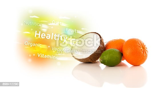 istock Colorful juicy fruits with healthy text and signs 898412290