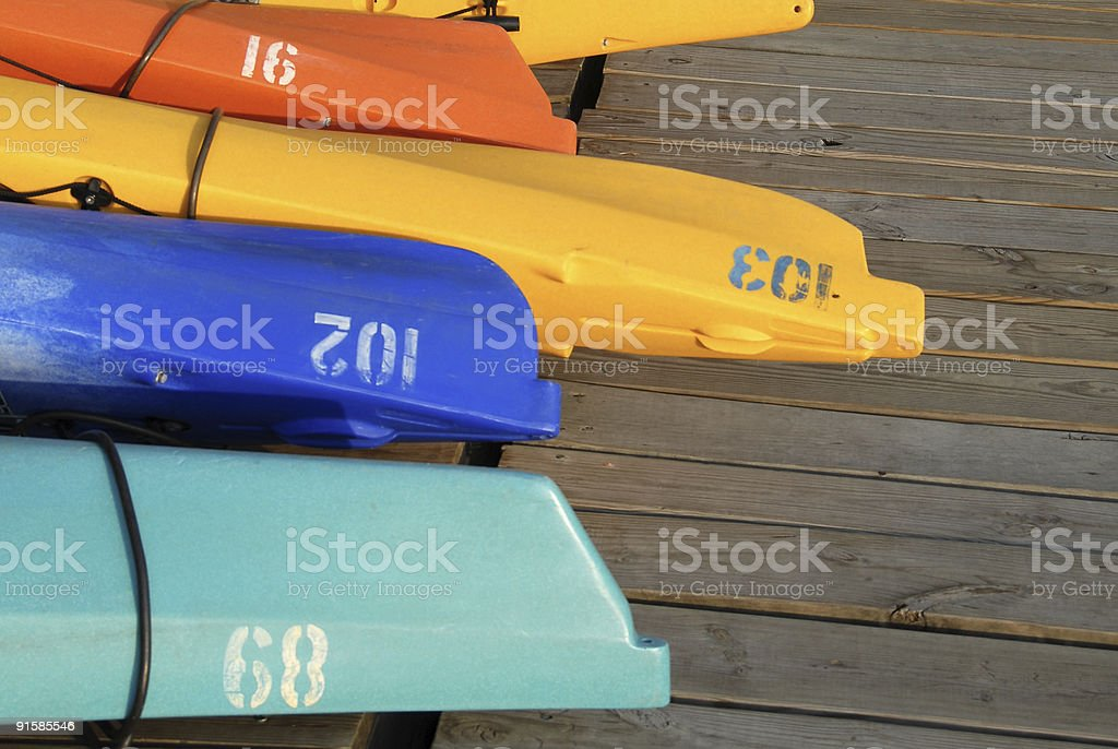 Colorful Kayaks and Boats on a Dock 3 stock photo