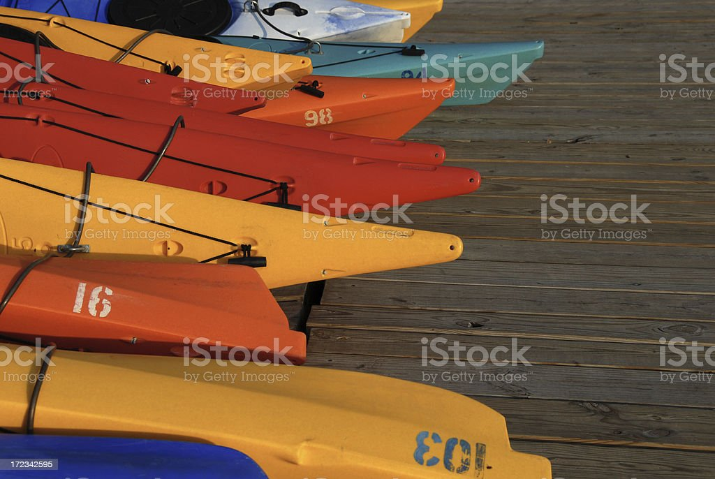 Colorful Kayaks and Boats on a Dock stock photo