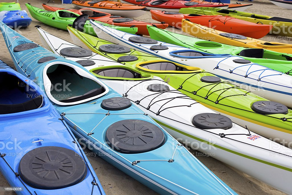 Colorful Kayaks in a Row stock photo