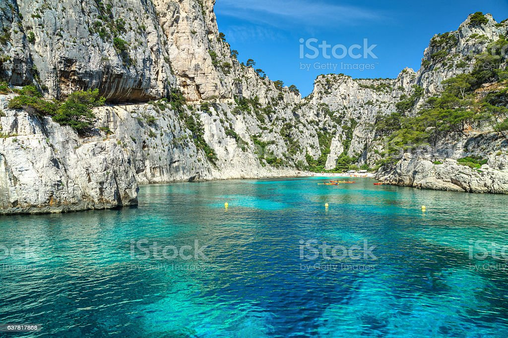 Colorful kayaks in the rocky bay, Cassis,near Marseille, France stock photo
