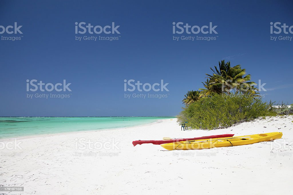 colorful kayaks on a beautiful beach in Anegada, BVI royalty-free stock photo