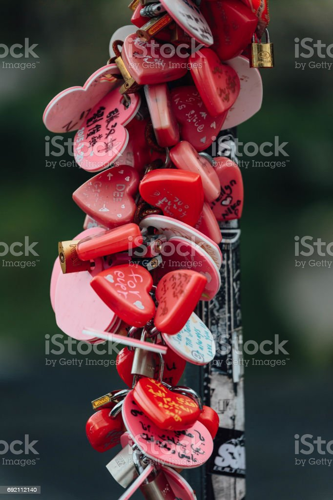 Colorful keychain holded on post lamp is called 'Love Lock Penang Hill' from Penang Hill at George Town. Penang, Malaysia. stock photo