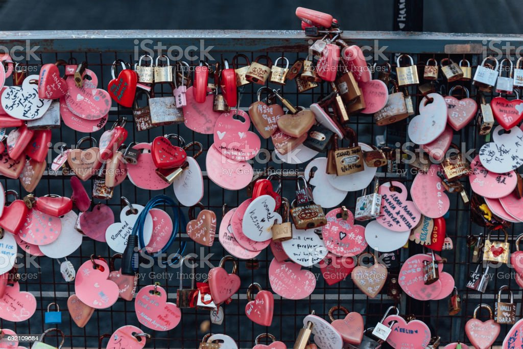 Colorful keychain holded on the bridge is called 'Love Lock Penang Hill' from Penang Hill at George Town. Penang, Malaysia. stock photo
