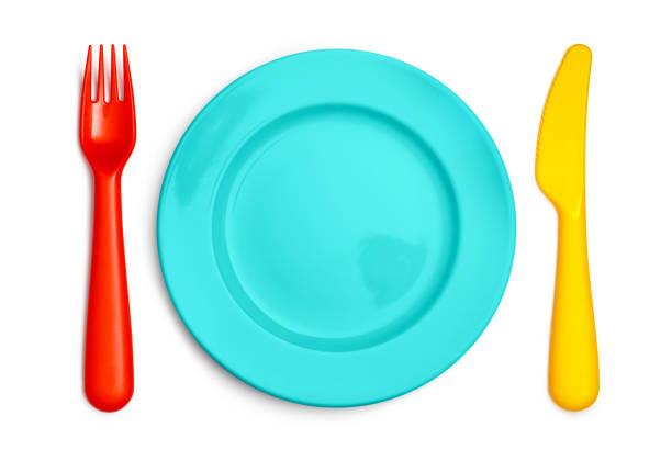 färgglada barn gaffel, tallrik och kniv på vitt - bordsskick bildbanksfoton och bilder