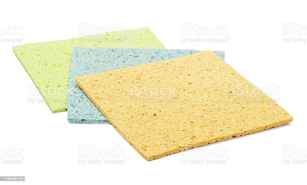 colorful kitchen sponges are isolated on a white royalty-free stock photo