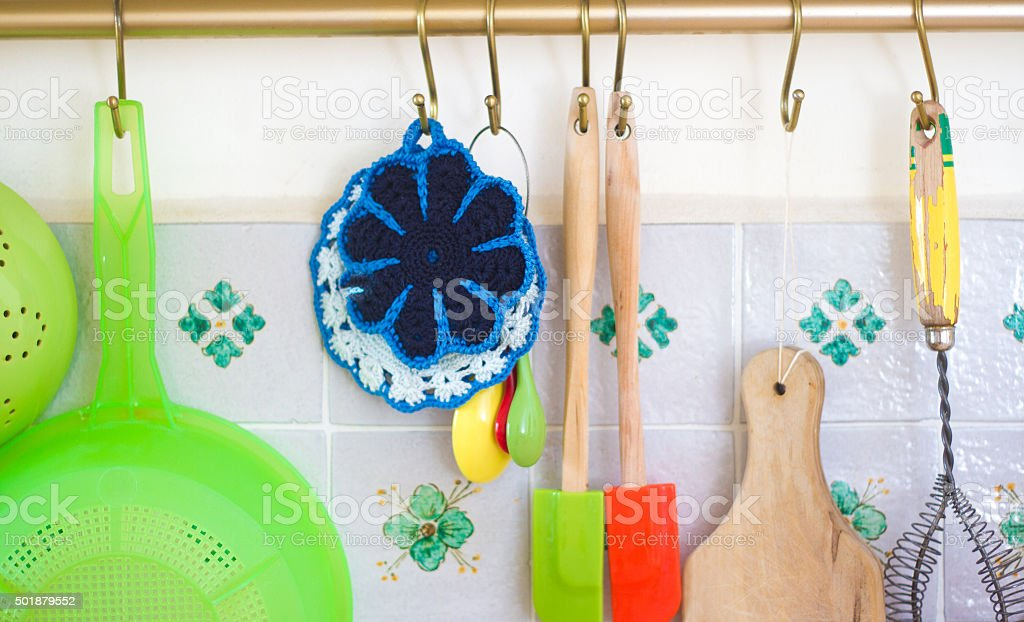 Colorful Kitchen Utensils Hanging Against Pretty Tiles Stock ...