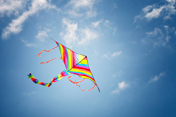 Colorful kite in the blue sky stock photo