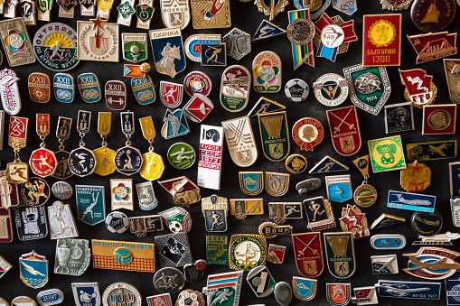 Set of colorful labels, stickers, medals, badges mostly sports from former Soviet Union on open market in Bukhara, Uzbekistan