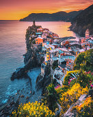 Colorful landscape view of  Vernazza village and harbor aerial view on beautiful sunset and flowers in Cinque Terre, Ligury, Italy. Seascape in Five lands in Cinque Terre National Park