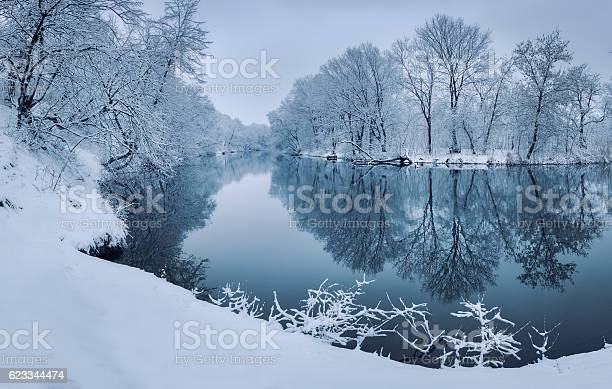 Photo of Colorful landscape with snowy trees, beautiful frozen river at sunset