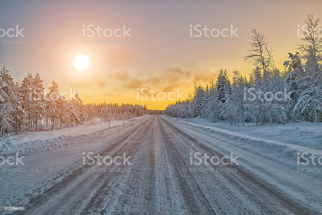 Colorful Lapland arctic day on winter road, Finland stock photo