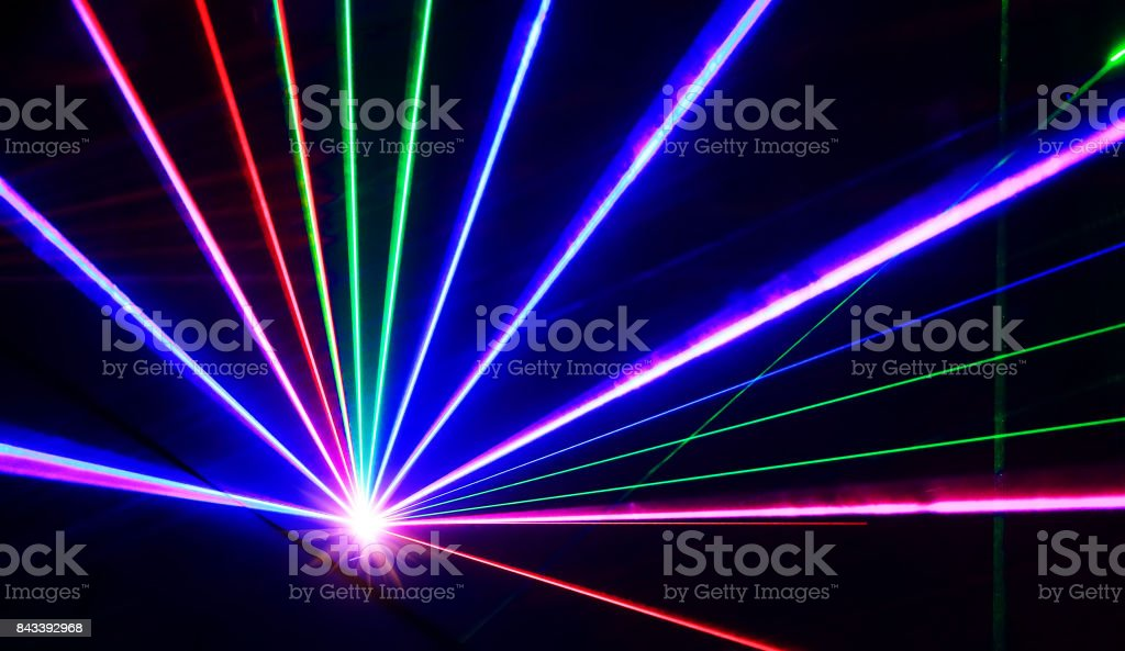Colorful laser lights lines on black stock photo