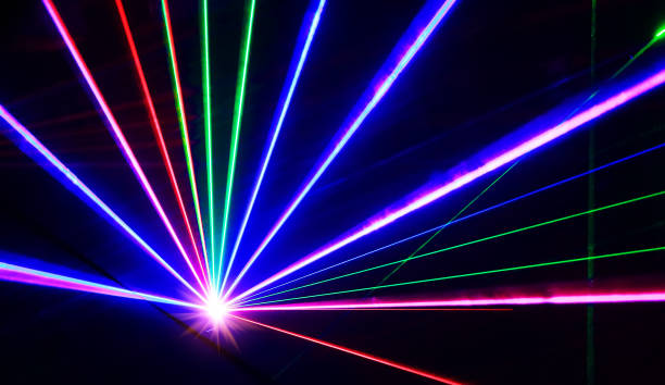 Colorful laser lights lines on black stock photo