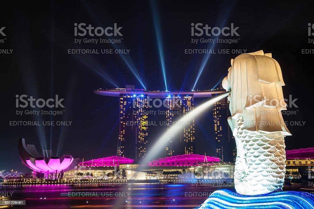 Colorful Laser Lights Up Singapore's Marina Bay Harbor at Night stock photo
