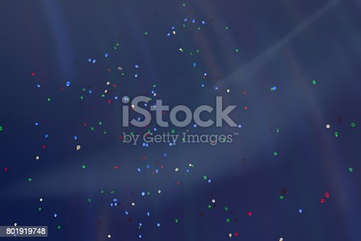 1035635902 istock photo Colorful LED balloons flying fly away in the sky at night with additional iridescent lighting. Many vivid fabulous Balloons glowing in the night sky 801919748