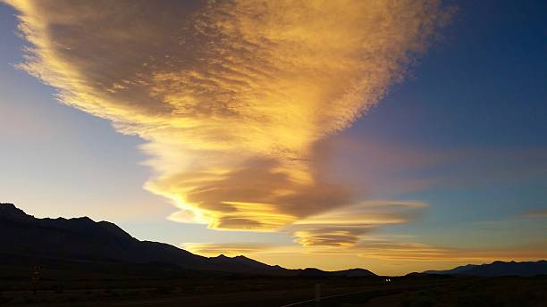 Colorful Lenticular Clouds in Independence California Beautiful, Colorful Lenticular clouds on the Summer Solstice in Independence, California. 2015 lenticular cloud stock pictures, royalty-free photos & images