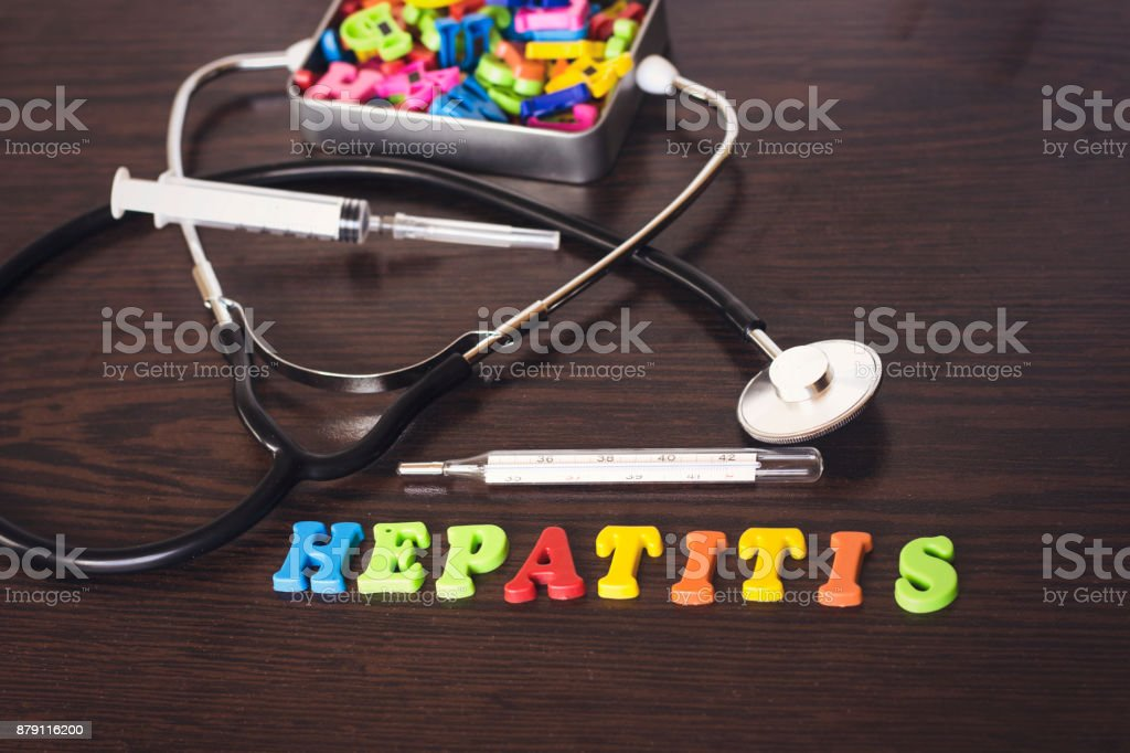 colorful letter hepatitis and thermometer,stethoscope,syringe,metal box of letters stock photo