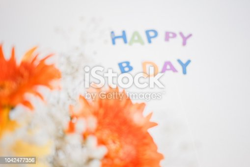 istock colorful letters happy birthday and gerbera bouquet. congratulation background 1042477356