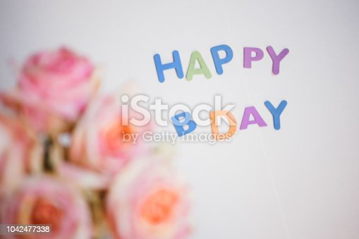 istock colorful letters happy birthday and roses bouquet congratulation background 1042477338