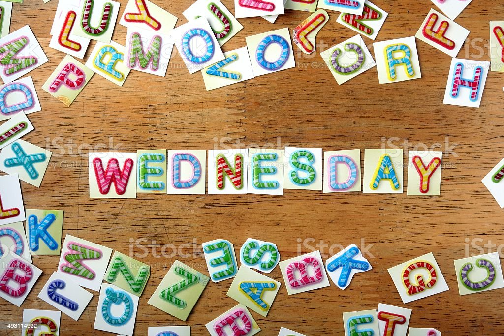 Colorful letters spelled as wednesday stock photo