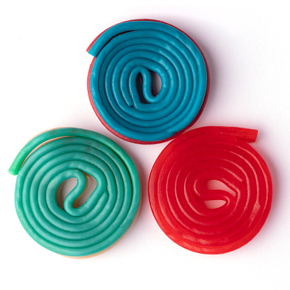 Colorful licorice candy snails on white