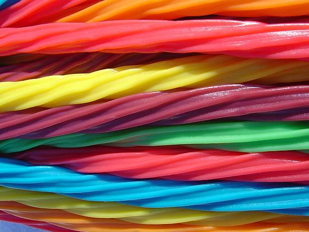 Colorful licorice wands arranged horizontally stock photo