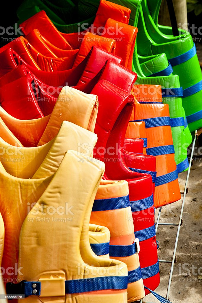 Colorful life vests in a row. stock photo