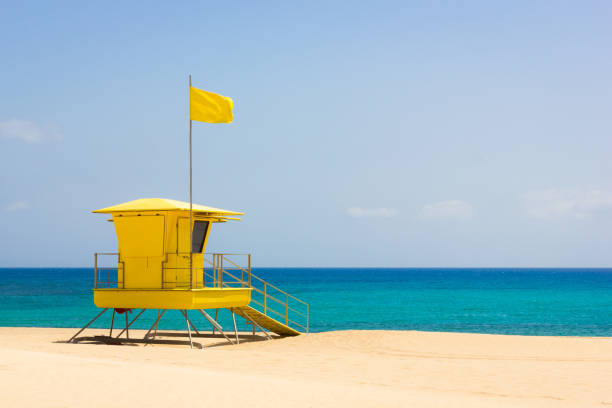 Colorful lifeguard tower off duty on empty beach in Corralejo natural park, Fuerteventura stock photo