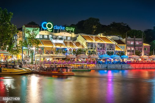 1097482486 istock photo Colorful light building at night in Clarke Quay, Singapore. 533421409