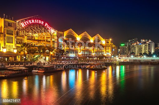 1097482486 istock photo Colorful light building at night in Clarke Quay, Singapore. 533421417