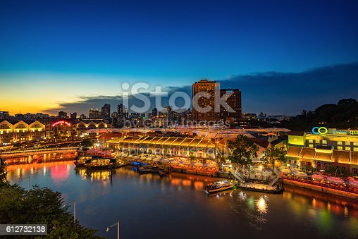 1097482486 istock photo Colorful light building at night in Clarke Quay Singapore 612732138