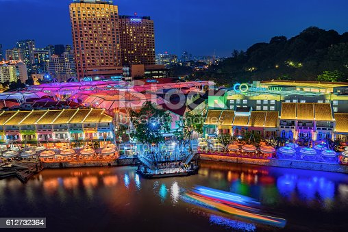 Singapore, Singapore - September 18, 2016: Colorful light building at night in Clarke Quay, Singapore. It is a historical riverside quay in Singapore, located within the Singapore River Area.