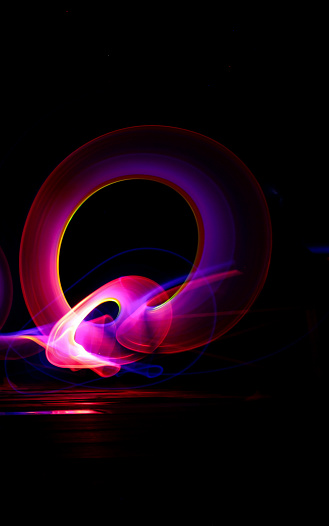Colorful light painting neon lights in long exposure shot with black background