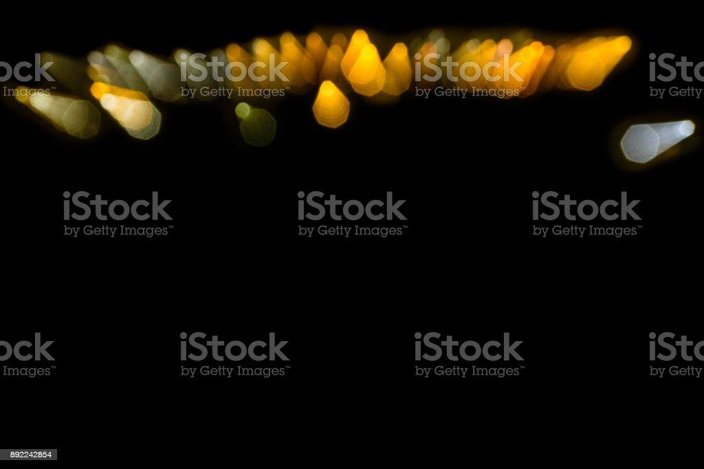 Pontos de luz coloridos em um fundo preto - foto de acervo