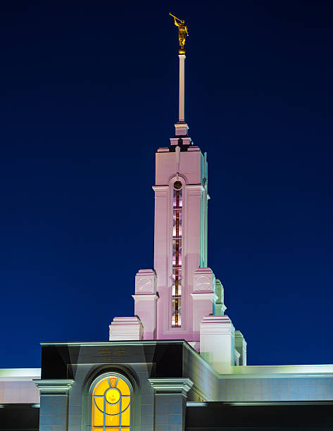 Colorful Lighted LDS Temple with Moroni stock photo
