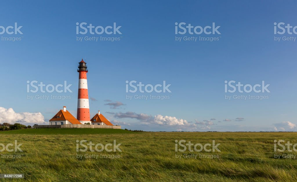 Colorful lighthouse at Westerhever, Germany stock photo
