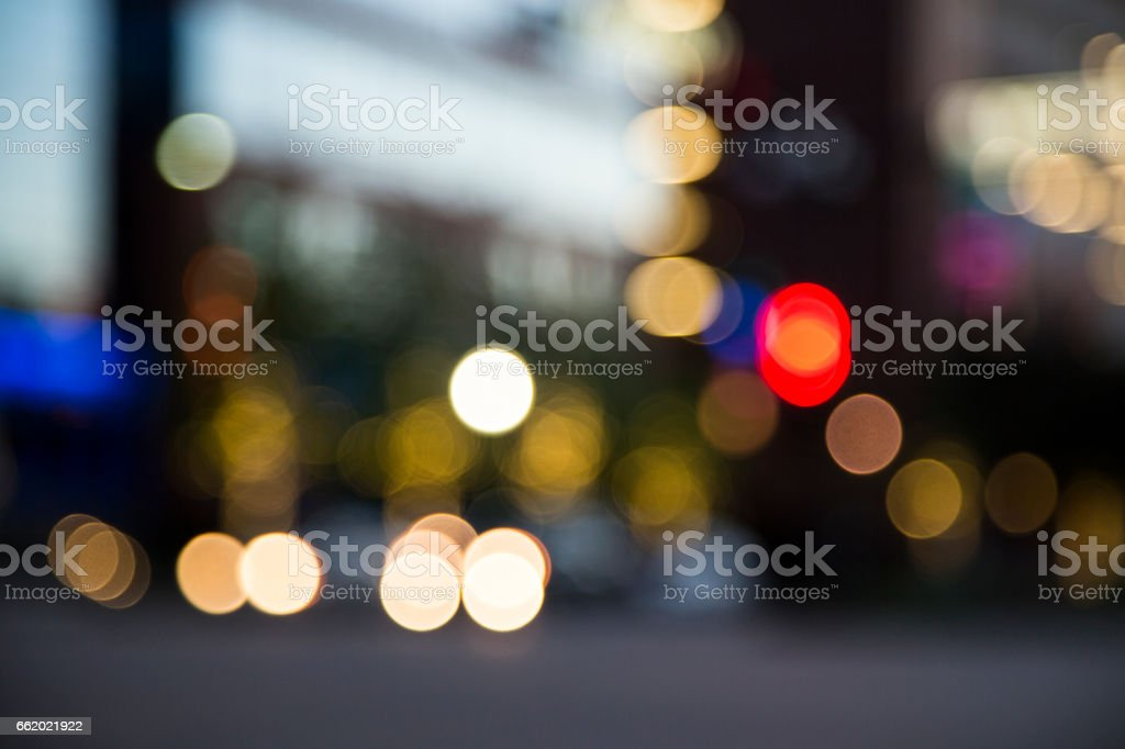 Colorful lights of defocused traffic intersection at dusk. royalty-free stock photo
