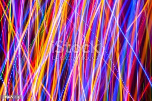 603907998 istock photo Colorful lights on the long exposure with motion background, Abstract glowing colorful lines, slow speed shutter 1190272241