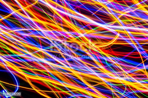 603907998 istock photo Colorful lights on the long exposure with motion background, Abstract glowing colorful lines, slow speed shutter 1190273220