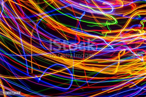 603907998 istock photo Colorful lights on the long exposure with motion background, Abstract glowing colorful lines, slow speed shutter 1190273444
