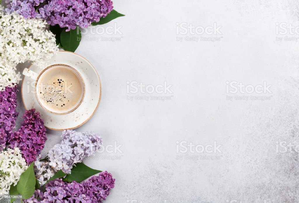 Colorful lilac flowers and coffee cup royalty-free stock photo