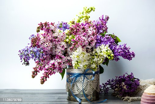Colorful lilac flowers bouquet in a vase