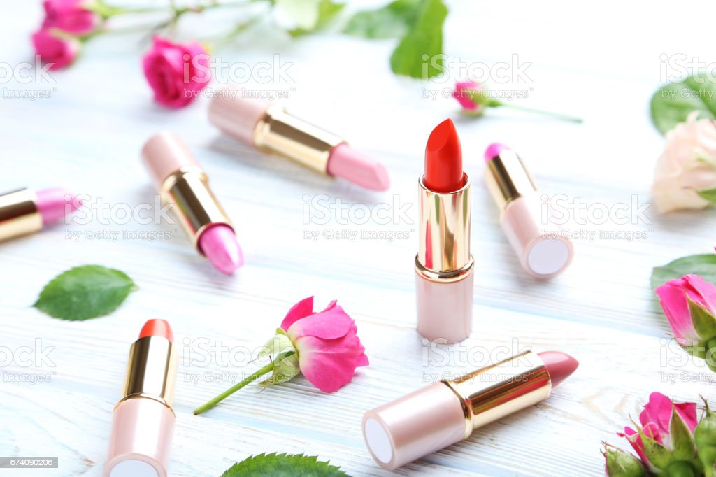 Colorful lipsticks on white wooden table royalty-free stock photo