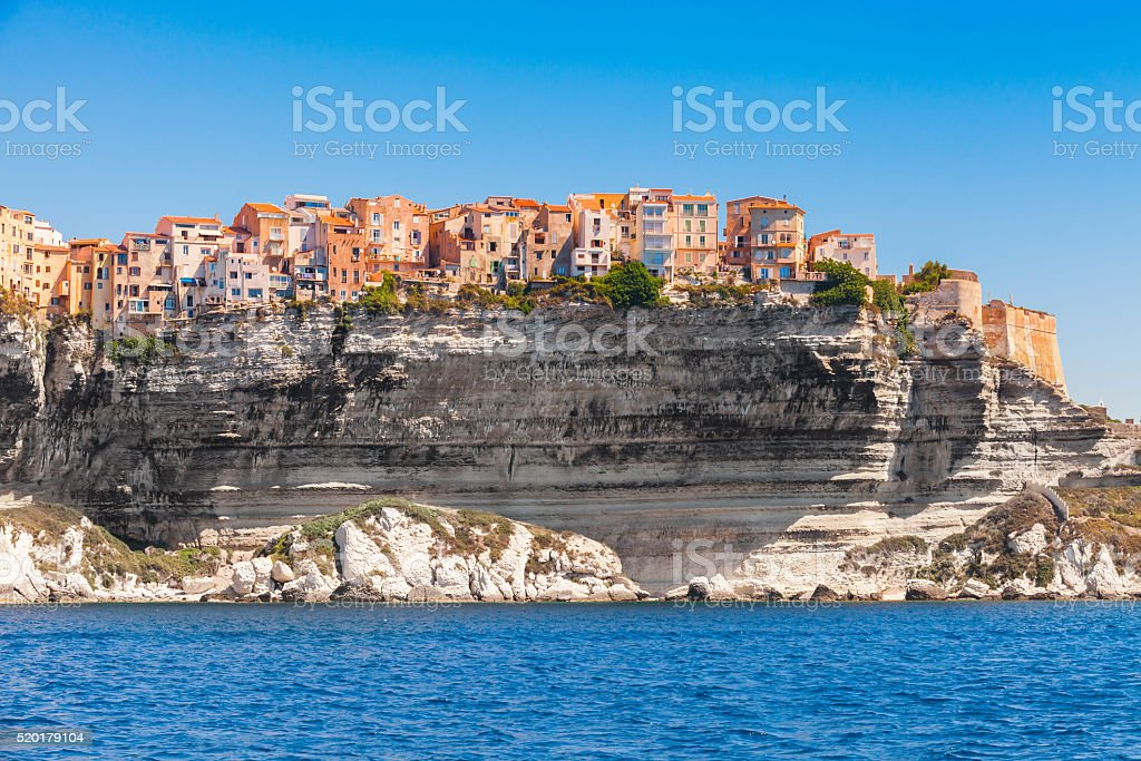 Colorful living houses on rocky coast, Bonifacio stock photo